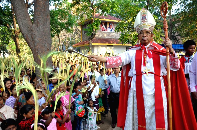 Telesphore Placidus Cardinal Toppo sprinkles holy water on the occasion of Palm Sunday in Ranchi on March 29, 2015.