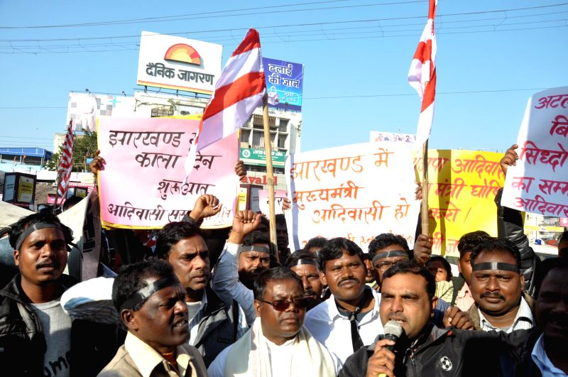 The members of Sarna Committee shout slogans to demand tribal chief minister in Jharkhand, in Ranchi on Dec 26, 2014.