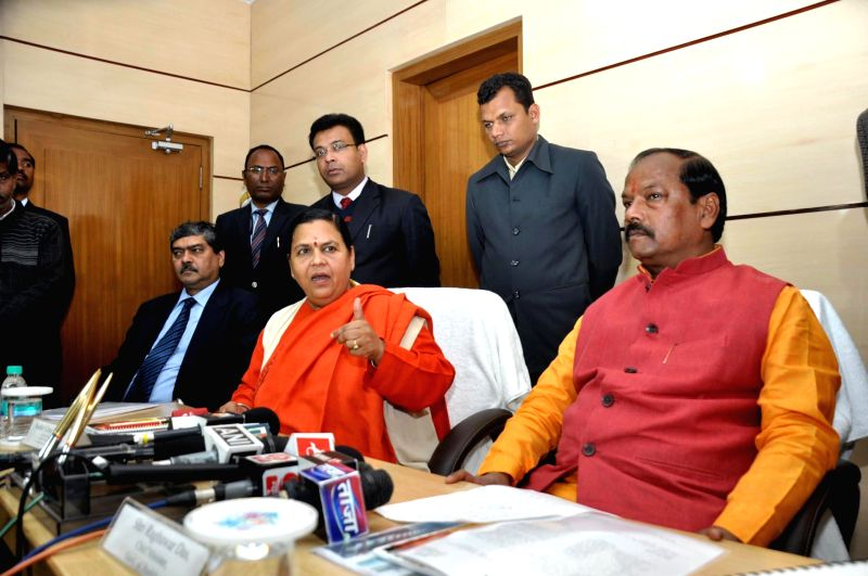 Union Minister for water resources, river development and Ganga rejuvenation Uma Bharti along with Jharkhand Chief Minister Raghubar Das address a press conference in Ranchi on Feb. 3, 2015.