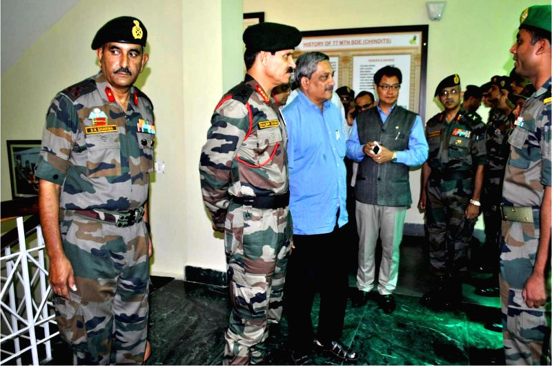Union Defence Minister Manohar Parrikar visits Army camp of the Red Horns Division in Rangiya, Assam, on May 2, 2015. Also seen Union MoS Home Affairs Kiren Rijiju and the Chief of Army ... - Dalbir Singh