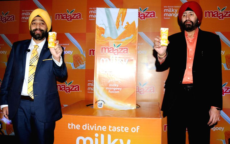 Ranjeet Kohli, Director (Franchise Bottling Operations), Coca-Cola India and Gurdeep Singh Kandhari, Director, Wave Beverages Pvt. Ltd. during a press conference to launch a new product in Amritsar .. - Ranjeet Kohli and Gurdeep Singh Kandhari