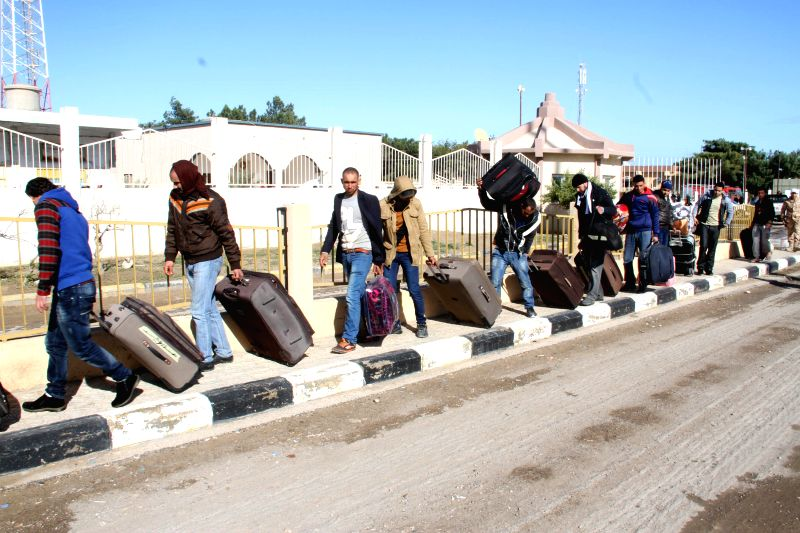 Egyptians walk to the Libyan-Tunisian border in Ras Jadir, Libya, on Feb. 23, 2015. Hundreds of Egyptian workers have been evacuating from Libya after the Islamic ...