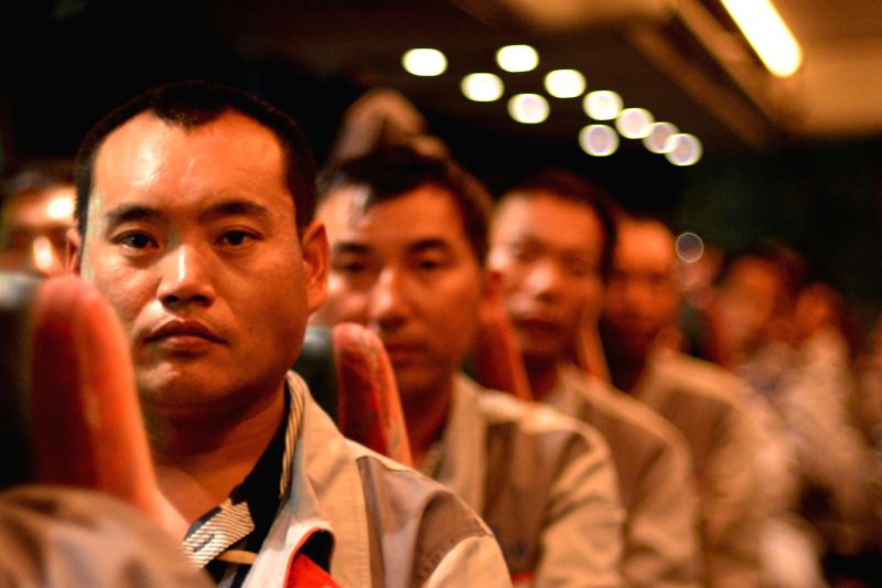 RAS JADIR (TUNIS), Aug. 3, 2014 Chinese evacuees wait to enter Tunisia in a coach at the Ras Jadir border control between Tunisia and Libya, late on Aug. 2, 2014. A total of 97 Chinese ...