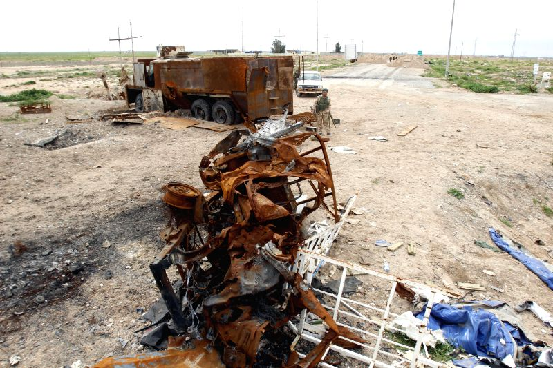 A destroyed vehicle of Islamic State (IS) is seen in the Rashad district in southwest of Kirkuk, Iraq, March 12, 2015. Kurdish security forces, known as Peshmerga, ...