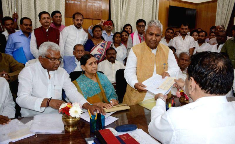 Rashtriya Janata Dal leader Ram Chander Purve files nomination papers for the April 26 Bihar council polls at Bihar Legislative Assembly in Patna, on April 13, 2018.