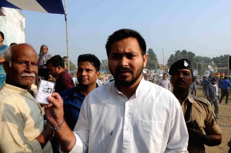 Rashtriya Janata Dal leader Tejashwi Yadav arrives to cast his vote during the third phase of Bihar assembly polls in Patna on Oct 28, 2015.