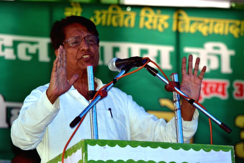 Rashtriya Lok Dal chief Ajit Singh addresses an election campaign rally in Agra on July 21, 2016. - Ajit Singh