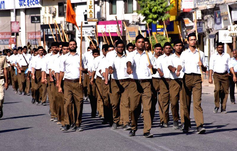 Rashtriya Swayamsevak Sangh (RSS) volunteers participate in a route march organised on RSS foundation day in Jaipur, on Sept 30, 2017.