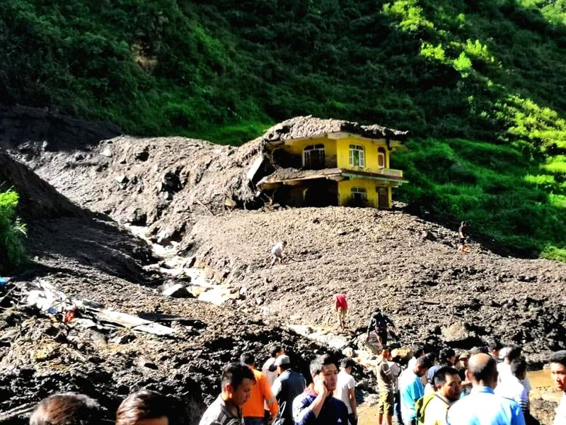 RASUWA, July 26, 2018 - People gather at the site of landslide in Timure, Rasuwa, Nepal, July 26, 2018. At least 4 people were killed and many others missing after landslides struck the small town on ...