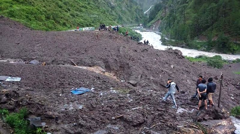 RASUWA, July 26, 2018 - Rescuers search for survivors at the site of landslide in Timure, Rasuwa, Nepal, July 26, 2018. At least 4 people were killed and many others missing after landslides struck ...