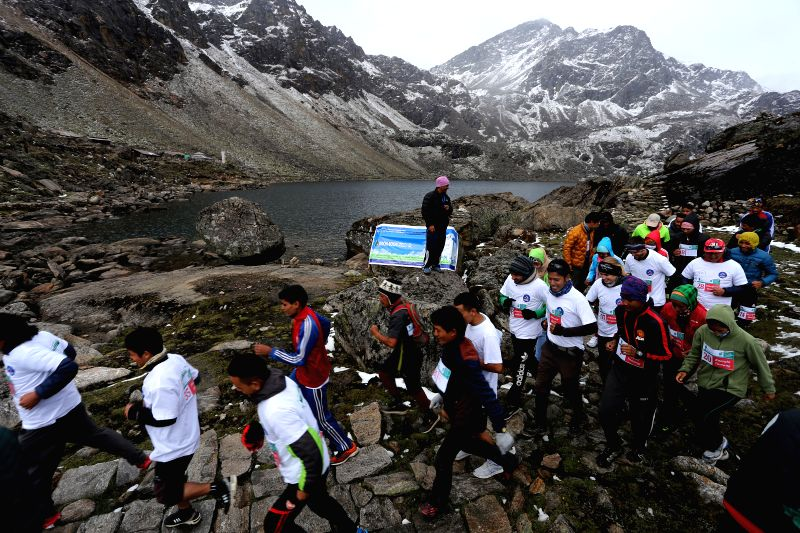 RASUWA, May 29, 2016 - Domestic and foreign athletes compete during the First Trekking Agencies' Association of Nepal (TAAN) Langtang-Gosainkunda Half Marathon 2016 at the sacred Gosainkunda lake, ...