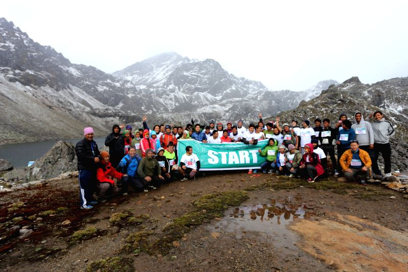 RASUWA, May 29, 2016 - Domestic and foreign athletes pose for a group photo before the start of the First Trekking Agencies' Association of Nepal (TAAN) Langtang-Gosainkunda Half Marathon 2016 at the ...