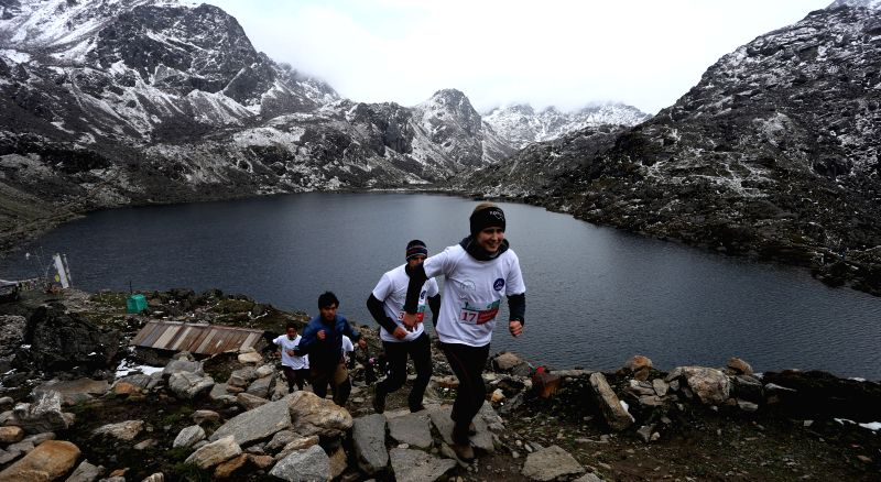 RASUWA, May 29, 2016 - Foreign athletes compete during the First Trekking Agencies' Association of Nepal (TAAN) Langtang-Gosainkunda Half Marathon 2016 at the sacred Gosainkunda lake, with an ...