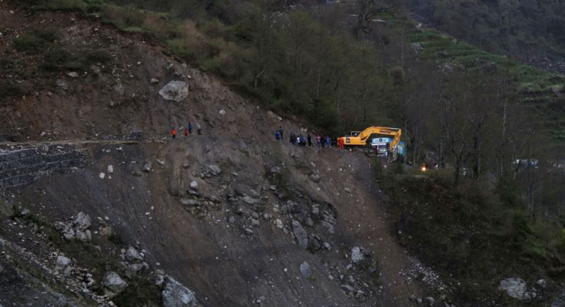 RASUWA, May 31, 2016 - Photo taken on May 30, 2016 shows vehicles lining up on a landslide-hit road at Thade near Dhunche in Rasuwa, Nepal. The road often encounters landslides during monsoon season, ...
