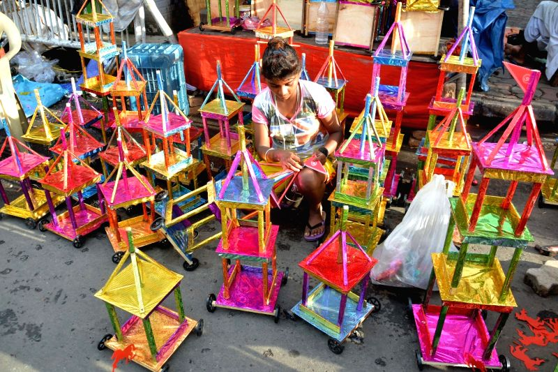Raths -chariots- being sold on the eve of Jagannath Rath Yatra in Kolkata, on July 13, 2018.