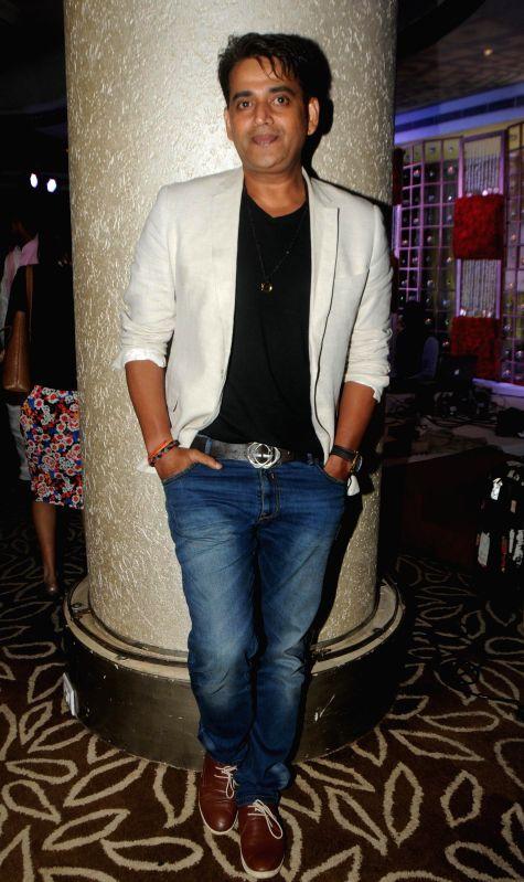 Ravi Kishan during Anup Jalota`s 56th birthday celebrations in Mumbai on July 29, 2014.