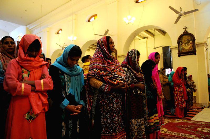 Pakistani people attend a service marking Easter at a church in Rawalpindi, Pakistan, April 5, 2015.