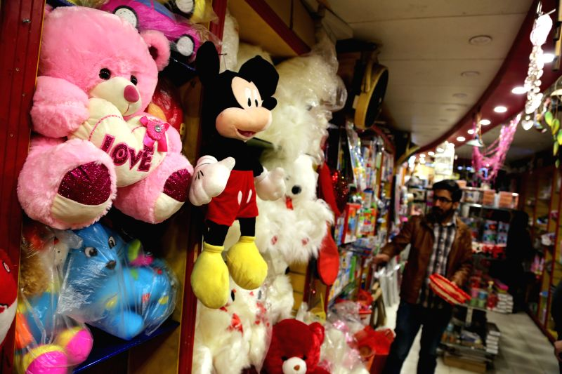 RAWALPINDI, Feb. 13, 2018 - A man buys gifts on the eve of Valentine's Day at a shop in Rawalpindi, Pakistan on Feb. 13, 2018.
