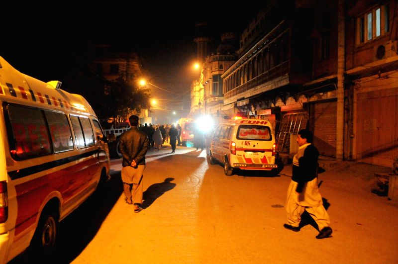 Ambulances park near the suicide blast site in Rawalpindi, Pakistan, Jan. 9, 2015. At least eight people were killed and 20 others injured when a suicide bomber .