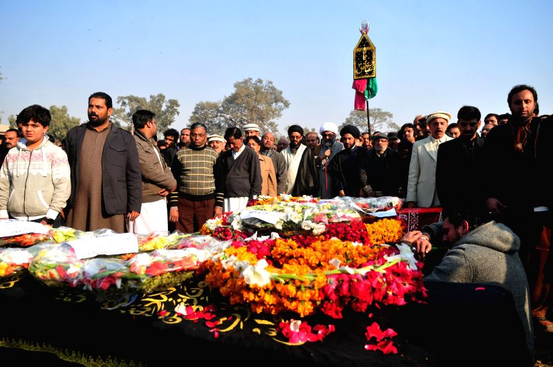 Pakistani Muslims attend the funeral ceremony of suicide blast victims in Rawalpindi, Pakistan, on Jan. 10, 2015. At least eight people were killed and 20 others