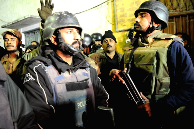 Pakistani security forces secure the suicide blast site in Rawalpindi, Pakistan, Jan. 9, 2015. At least eight people were killed and 20 others injured when a ...