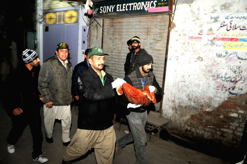 Pakistani security officials remove unexploded bomb from the blast site in Rawalpindi, Pakistan on Jan. 9, 2015. At least eight people were killed and 20 others ..