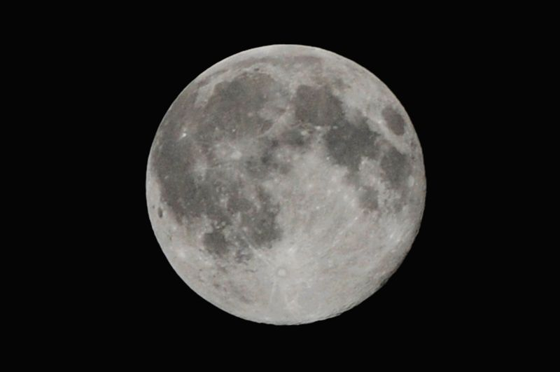 The full moon is seen in the sky in Rawalpindi, Pakistan on July 12, 2014.