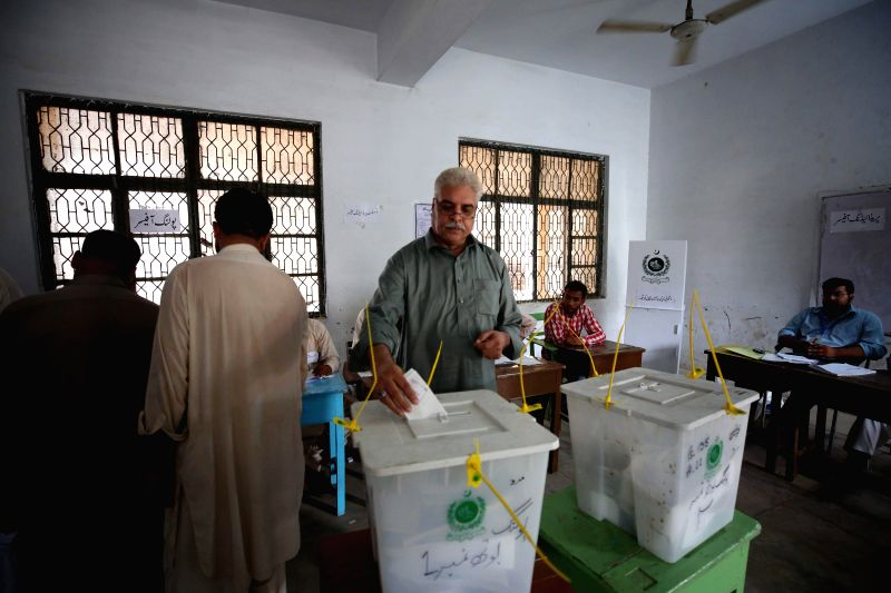 RAWALPINDI, July 25, 2018 - A man casts vote at a polling station during the general elections in Rawalpindi, Pakistan, on July 25, 2018. Pakistan held the general elections on Wednesday.
