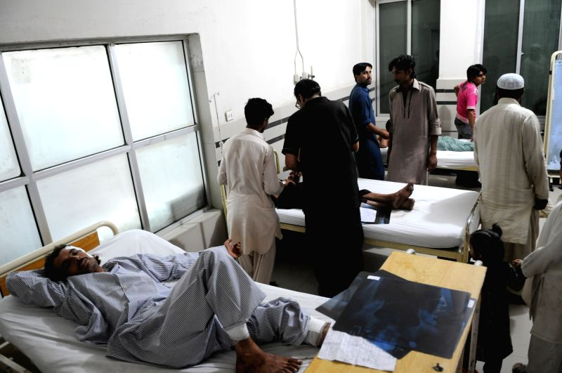 Injured people receive medical treatment at a hospital in Rawalpindi, adjacent city of Islamabad, capital of Pakistan, June 21, 2014. At least 41 people were ...