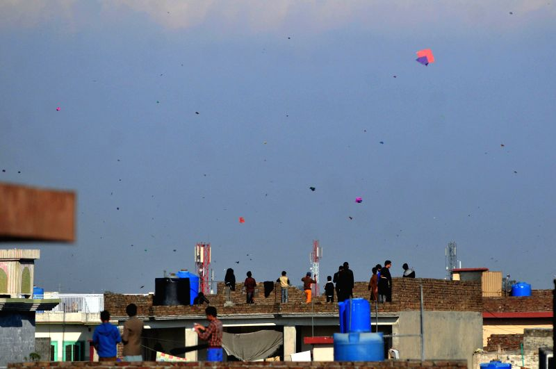 Pakistanis fly kites during the kite festival in Rawalpindi, Pakistan, March 6, 2015.