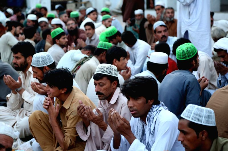 RAWALPINDI (PAKISTAN), June 7, 2018 Pakistani Muslims pray before breaking their daytime fast during the holy month of Ramadan, in Rawalpindi, Pakistan, on June 7, 2018.