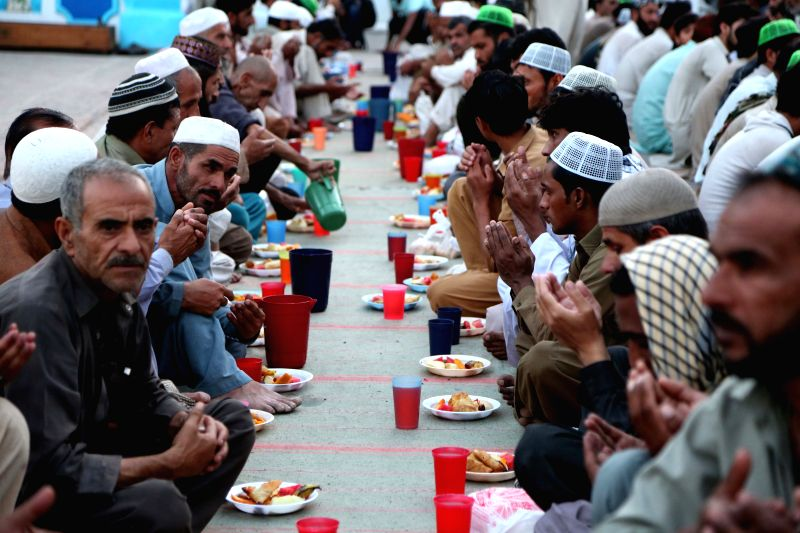 RAWALPINDI (PAKISTAN), June 7, 2018 Pakistani Muslims wait to break their daytime fast during the holy month of Ramadan, in Rawalpindi, Pakistan, on June 7, 2018.