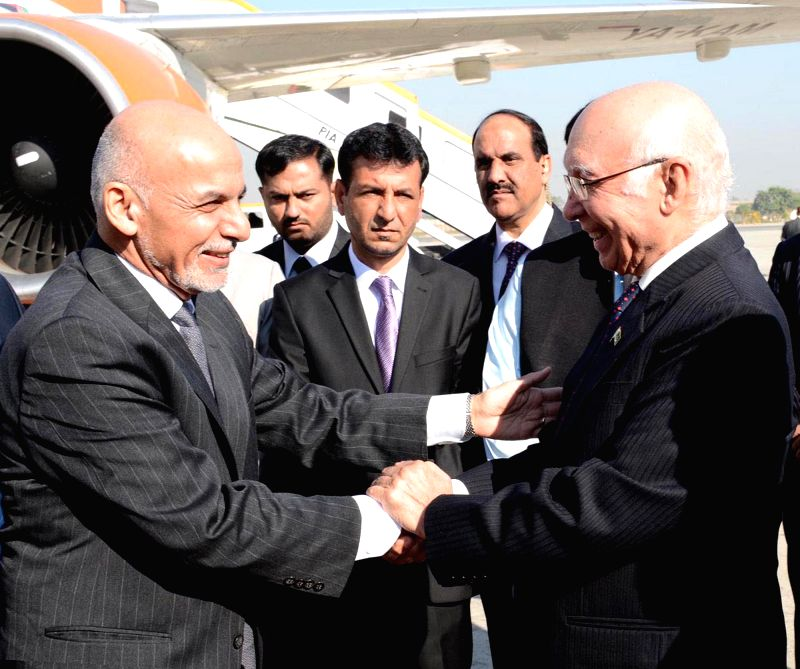 Photo released by Press Information Department (PID) on Nov. 14, 2014 shows Afghan President Ashraf Ghani (L, front) being welcomed by Sartaj Aziz (R, front), National Security Advisor to - Nur Khan