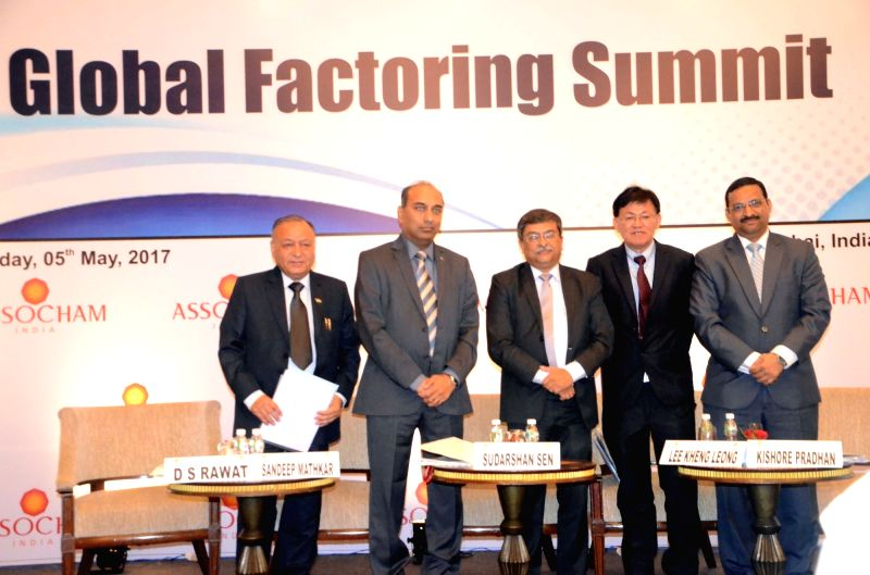 RBI Executive Director Sudarshan Sen with ASSOCHAM General Secretary D S Rawat, ASSOCHAM Chairman Sandeep Mathkar, FCI Asia Chapter Director Lee Kheng Leong and ASSOCHAM National Council ...