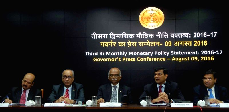 RBI Governor Raghuram Rajan addresses a press conference in Mumbai on Aug 9, 2016. Also seen RBI Deputy Governors SS Mundra, Urjit Patel, R Gandhi and NS Vishwanathan. - Urjit Patel and R Gandhi