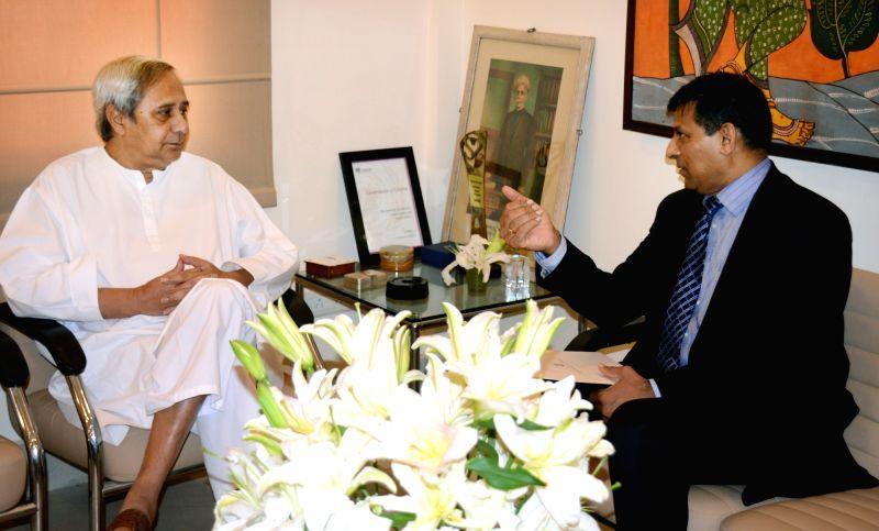 RBI Governor Raghuram Rajan calls on the Odisha Chief Minister Naveen Patnaik at Secretariat in Bhubaneswar on May 21, 2016. - Naveen Patnaik