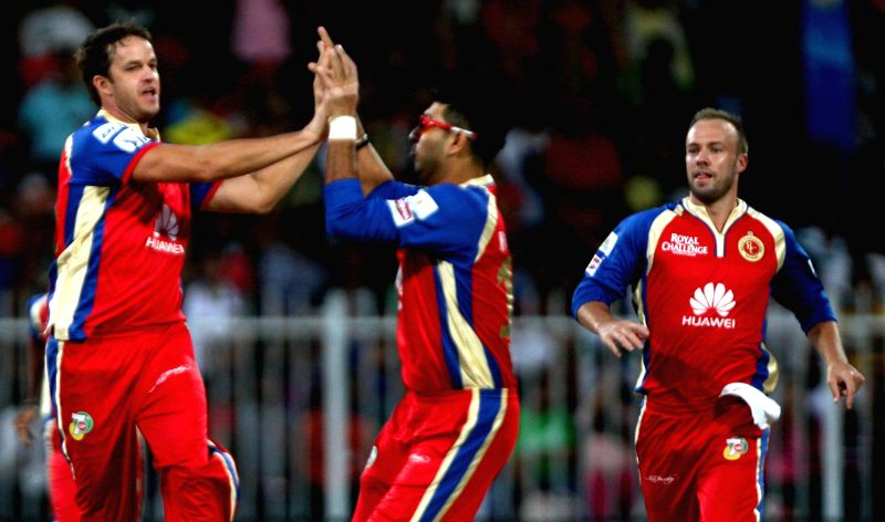 RCB players Albie Morkel, Yuvraj Singh and AB de Villiers celebrate fall of a wicket during the second match of IPL 2014 between Delhi Daredevils and Royal Challengers Bangalore, played at Sharjah ... - Yuvraj Singh