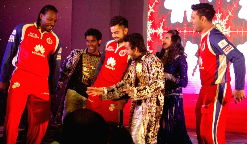 RCB players Chris Gayle, Virat Kohli and Yuvraj Singh during an promotional event held for Royal Challengers Bangalore players at a Hotel, in Bangalore on May 3, 2014. - Virat Kohli and Yuvraj Singh
