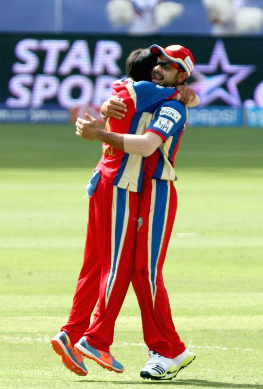 RCB players Virat Kohli and Yuzvendra Chahal celebrate fall of a wicket during the fifth match of IPL 2014 between Royal Challengers Bangalore and Mumbai Indians, played at Dubai International ... - Virat Kohli