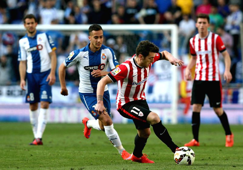 RCD Espanyol's midfielder Lucas Vazquez (L) fights for the ball with midfielder Ibai Gomez Perez (R) of Athletic Bilbao during their Primera Division soccer match played at Power 8 stadium in ...