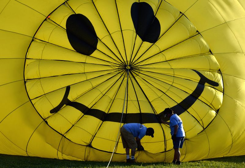 READINGTON (U.S.), July 26, 2014 People prepare to fly their balloons during the 32nd, annual QuickChek New Jersey Festival of Ballooning at Solberg Airport in Readington Township, New ...