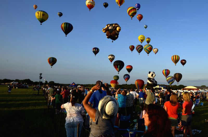 READINGTON (U.S.), July 26, 2014 People watch balloons during the 32nd, annual QuickChek New Jersey Festival of Ballooning at Solberg Airport in Readington Township, New Jersey of the ...