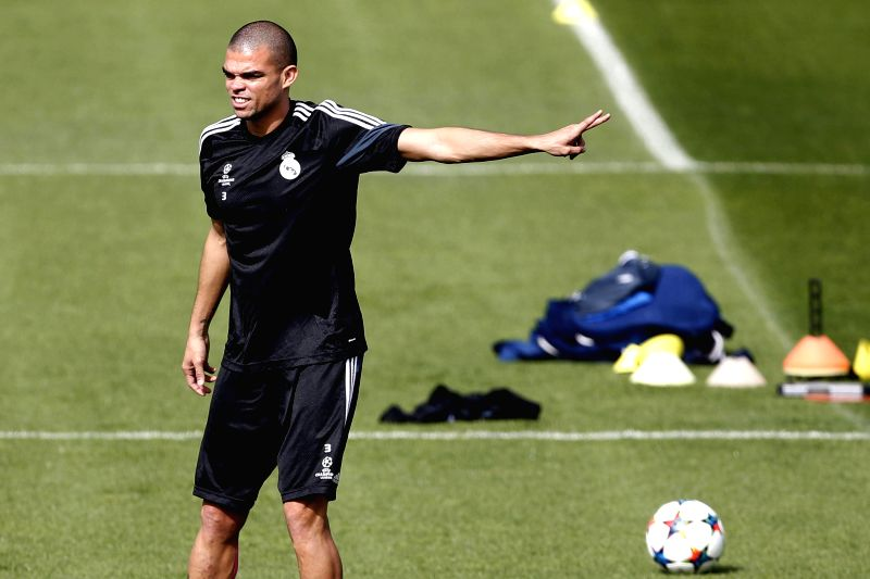 Real Madrid's Portuguese defender Pepe takes part in a training session held at the team's sports complex in Valdebebas, Madrid, Spain, 13 April 2015. Real Madrid will face Atletico Madrid in a UEFA ...