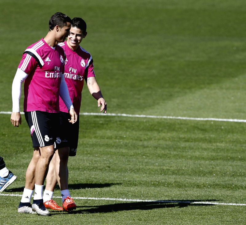 Real Madrid's Portuguese forward Cristiano Ronaldo and Colombian James take part in a training session held at the Valdebebas sports city in Madrid, Spain, 07 April 2015. Real Madrid will face Rayo ...