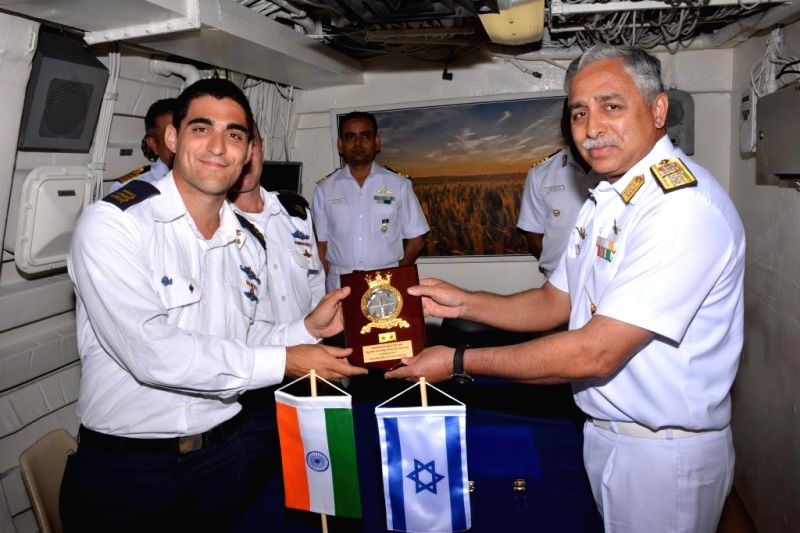 Rear Admiral RB Pandit FOCWF greets & exchanges crests with Commander 3rd Flotilla & CO Israel Navy Ship Hanit