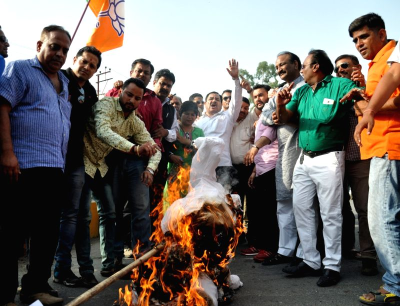 Rebel Congress leader Harak Singh Rawat and his supporters  stage a demonstration against Uttarakhand Chief Minister Harish Rawat in Dehradun, on May 25, 2016. - Harish Rawat and Harak Singh Rawat