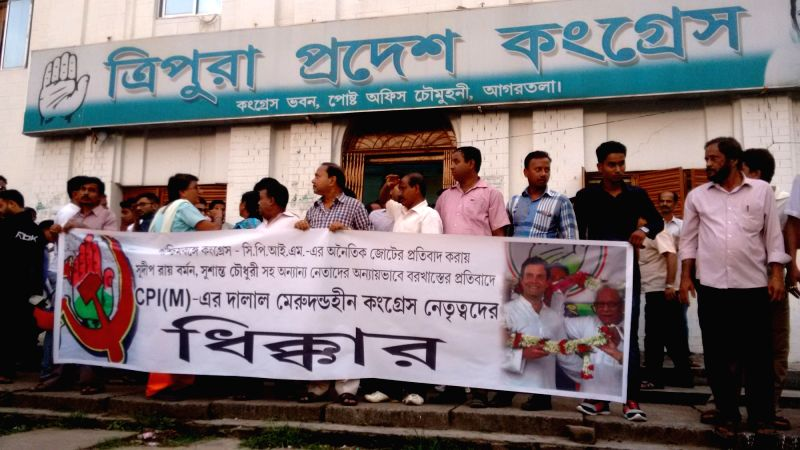 Rebel party workers protest in front of the Congress against the suspension of Congress MLA Sudip Roy Barman for his anti-party activity in Agartala May 7, 2016. - Sudip Roy Barman