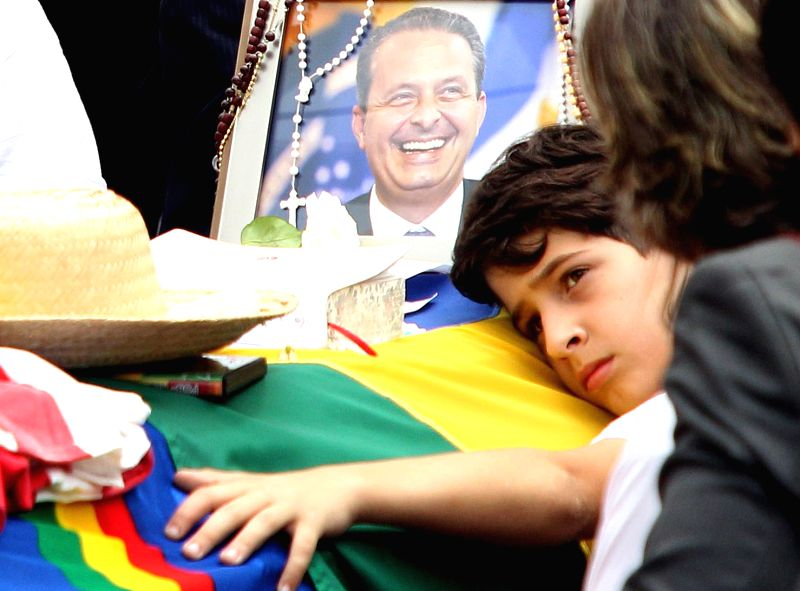 Jose, son of the late presidential candidate Eduardo Campos reacts durnig the funeral in Recife, Brazil, on Aug 17, 2014. Thousands of Brazilians gathered in the ...
