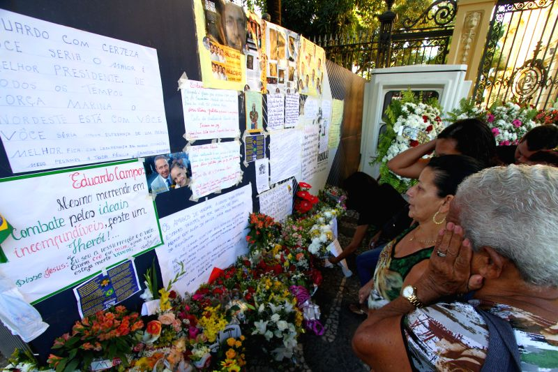 People place flowers and images of the presidential candidate Eduardo Campos in front of Palacio do Campo das Princesas, in the city of Recife, Brazil, on Aug 16, ...