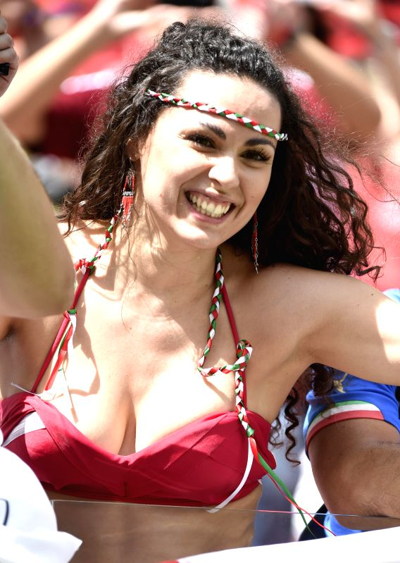 An Italy's fan poses before a Group D match between Italy and Costa Rica of 2014 FIFA World Cup at the Arena Pernambuco Stadium in Recife, Brazil, on June 20, 2014.
